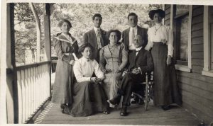 Family Group with Louis and Elizabeth Green seated in chairs with their five adult children – two sons and three daughters
