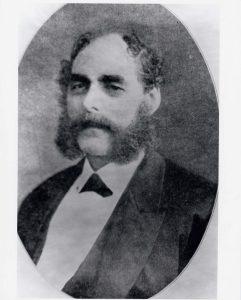 Portrait officiel en noir et blanc de Solomon Hart portant des favoris en côtelette.
