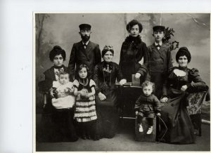 Family portrait showing three generations of the Tanzman family including three children and five adults