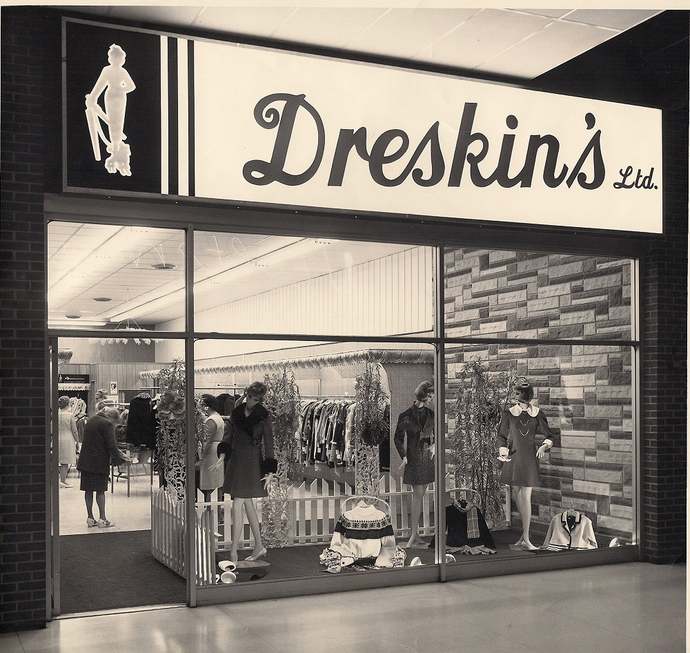 Storefront for Dreskin's Ltd. in Lancaster Shopping Mall – window display includes three mannequins and sweaters – shoppers can be inside store