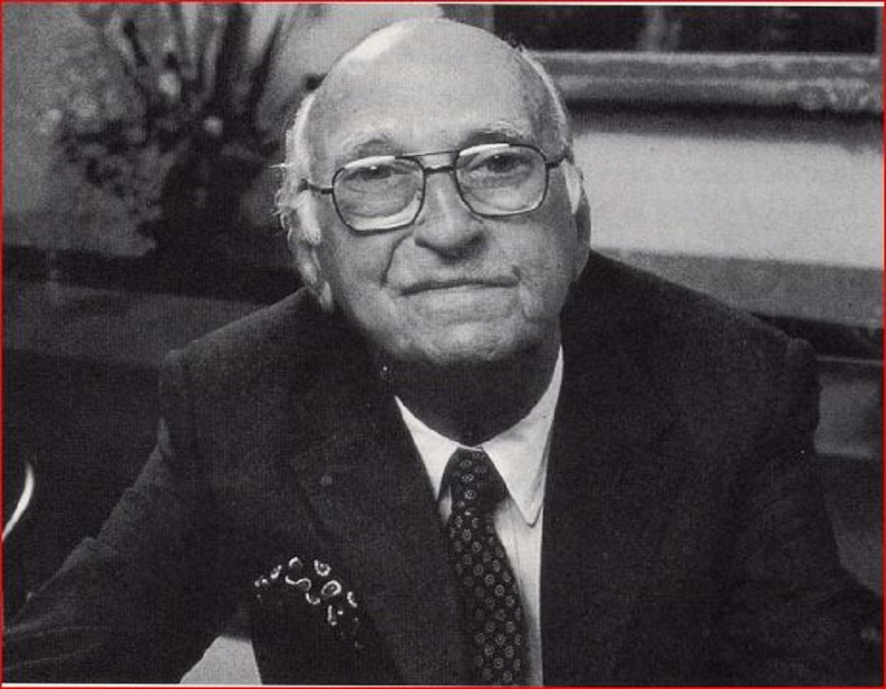 Portrait of bald man in business suit with glasses