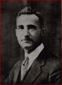 Formal portrait of man in business suit with mustache