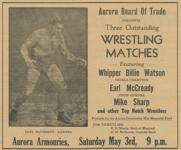 A black and white advertisement for wrestling matches containing written details about the event on the right and a photograph on the left of a man wearing tight fitting shorts, socks and boots standing in an aggressive lunge forward position