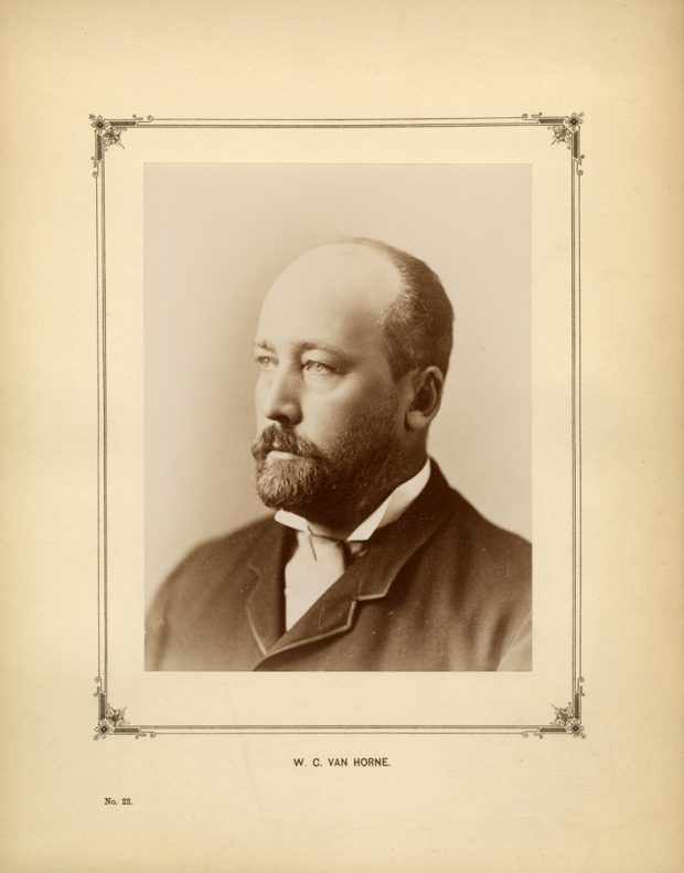 Sepia photo of a formal portrait of the upper body of a man looking to the left.