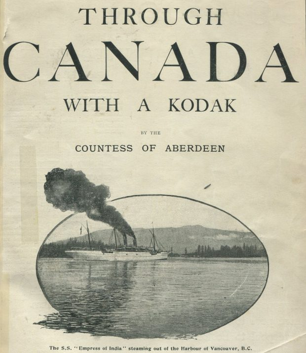 Book cover of Lady Aberdeen's 1893 book, Through Canada with a Kodak, with an oval photo of a ship sailing out of the Vancouver harbour