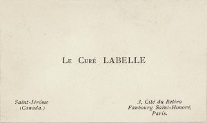"Image of a small rectangular white card: printed in the centre, in black ink, are the words ""Le Curé Labelle."" At bottom left and right are the curé's addresses in Canada and France."