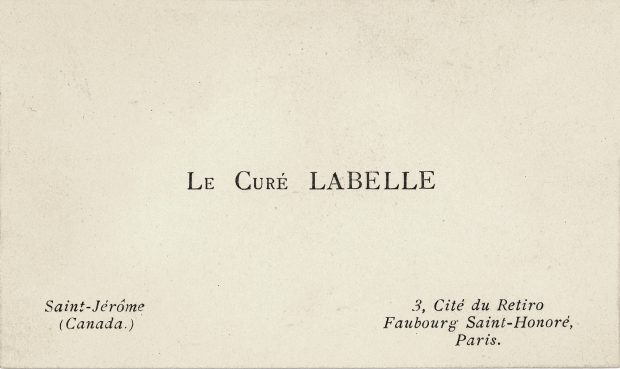 """Image of a small rectangular white card: printed in the centre, in black ink, are the words """"Le Curé Labelle."""" At bottom left and right are the curé's addresses in Canada and France."""