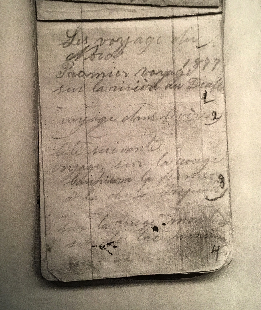 """Photograph of a page from a notebook. Handwritten in pencil are the words """"Les voyages du Nord. 1877, Premier voyage sur la rivière du Diable"""" (""""Travels Northward. 1877, first trip on the Diable River""""). A number of other destinations follow."""