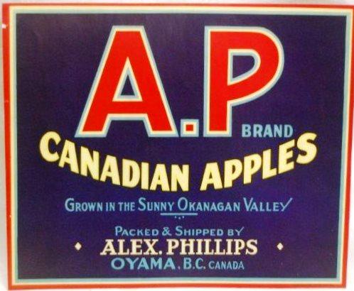 Photo en couleur d'une étiquette de caisse de pommes de la marque A.P. Le fond de l'étiquette est bleu foncé; les bords et les lettres sont rouges, blancs, jaunes et bleu clair.