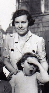 Black and white photo of a woman and a young girl standing outside.