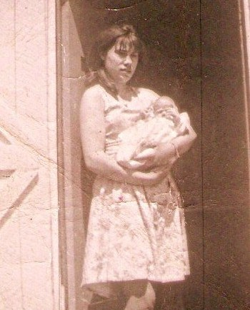 Jane Hayse with baby. This picture is of Jane Hayse just before she left Parker's Cove to go to St. John's to work.