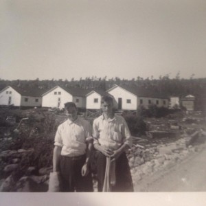Wilson King and Thomas King in front of buildings in the lumber camp
