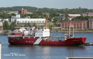 Coast Guard Ship-- Sir Humphrey Gilbert in the harbour. City view in the background