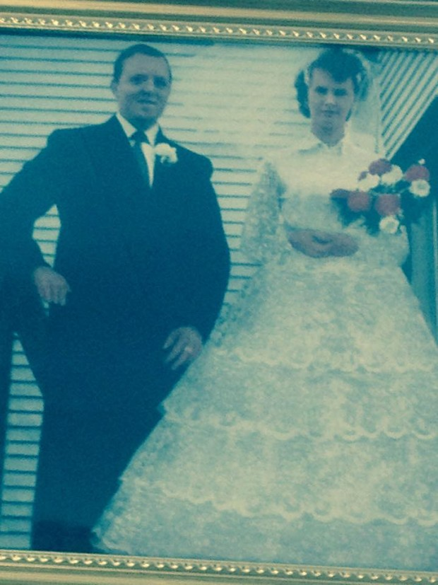 Mike and Priscilla Dicks standing on church steps on their wedding day 1960