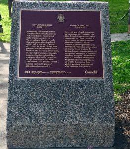 bronze plaque on concrete pedestal