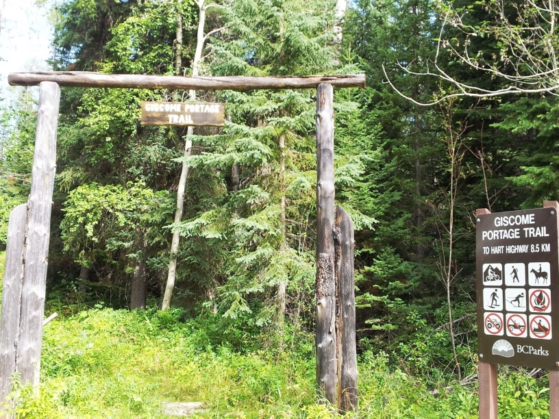 Giscome Portage Trail sign hanging from timber arch