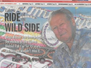 A newspaper article cover page called Take a Rode on the Wild Side. An older Bingo is featured in front of lit up carnival ride