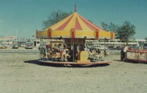 A small carousel at a carnival midway
