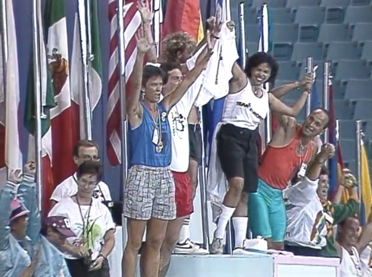 Athletes kid around and pose atop a multi-tiered podium at the Closing Ceremonies set up for last-minute photo-ops at the Closing Ceremonies.