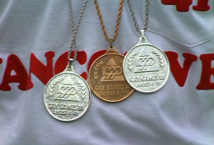 Close up of Gay Games III medals won, and being worn by, Vancouver track athlete, Eric Graff, at Swangard Stadium, Burnaby.