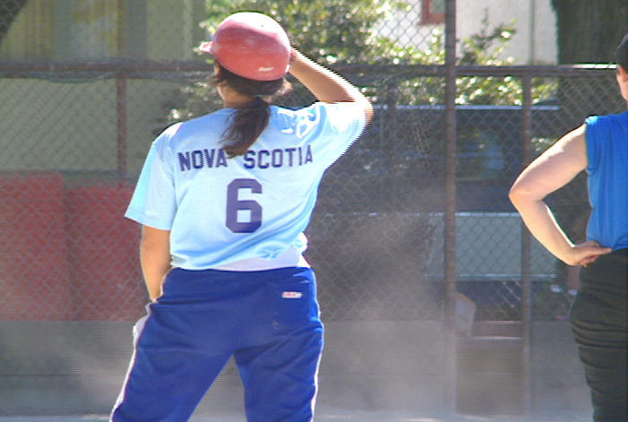 A woman softball player from the Nova Scotia team.