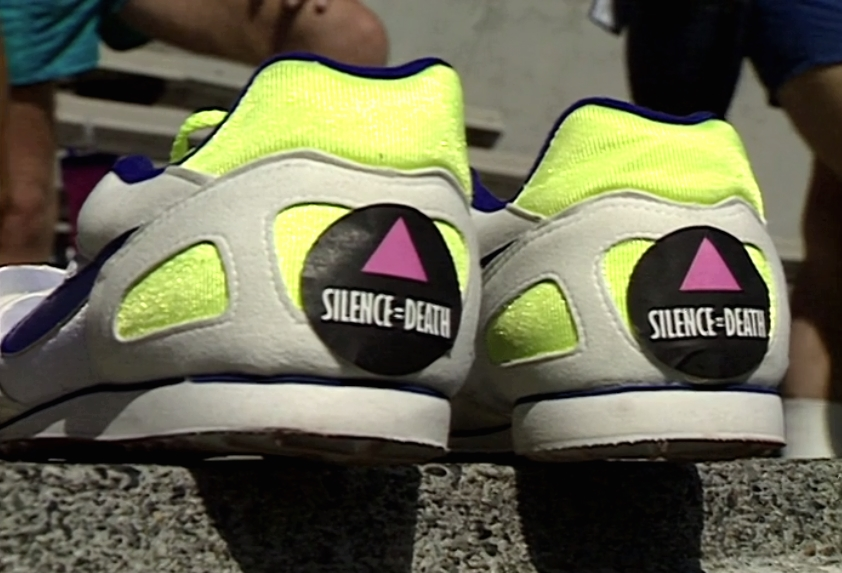 Running shoes with 'Silence=Death' stickers on their heels in the stands at Swanguard Stadium, Burnaby.
