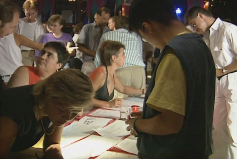 Staff and board signing up new volunteers at a recruitment drive and pep rally at the Commodore Ballroom.
