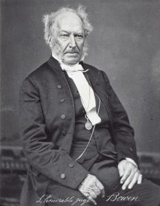 Black white. Older man in a black suit and a white shirt.