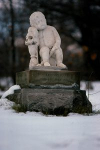 Marble baby headstone in the winter