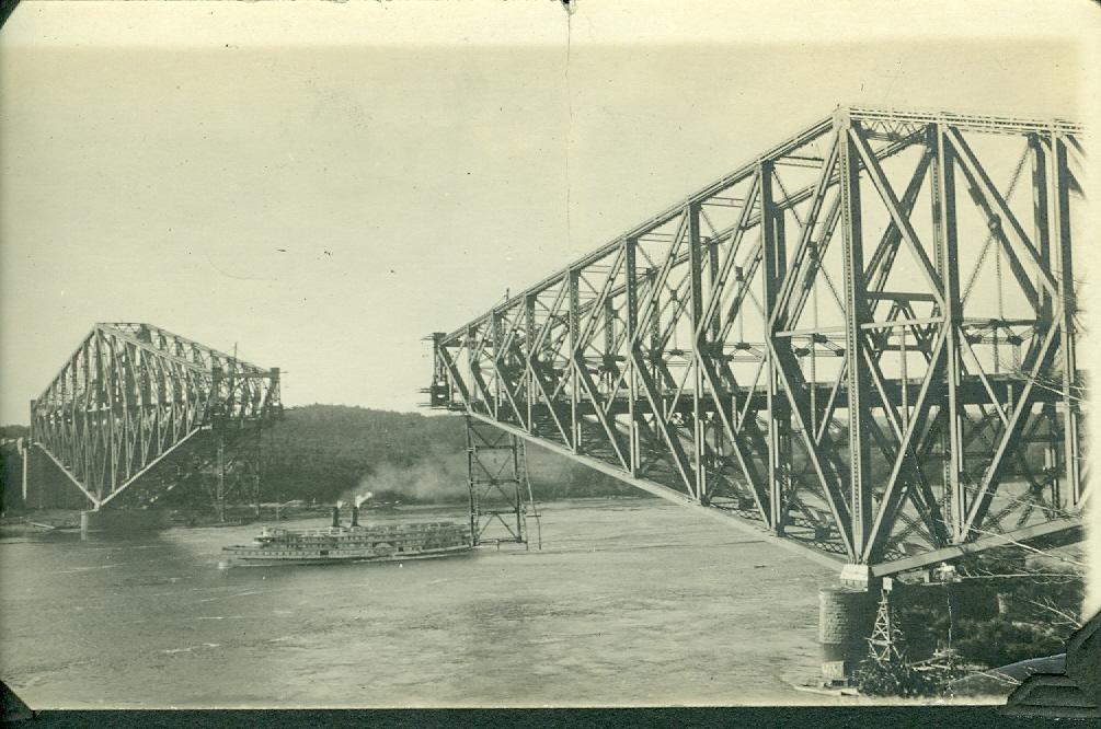 sepia photo of a bridge with no center span