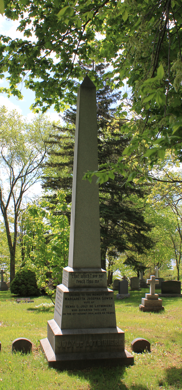 a large brown monument in the trees