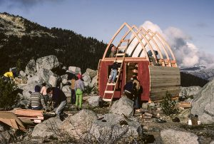 The frame of the hut has been erected and the arched roof is open to the elements and members of the UBC-VOC club are busy working on adding more tongue and groove siding and other aspects of the hut construction.
