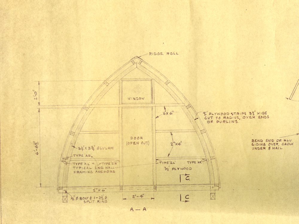 Part of the original technical drawing in black pen with specifics on the front entrance of the Gothic arch hut.