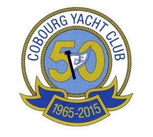 a logo made with a double circle of gold coloured ropes with the words Cobourg Yacht Club between, the years 1965-2015 in gold on blue at the bottom and a blue and white flag over a gold 50 on blue in the middle