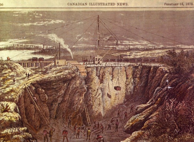 a coloured etching from the Canadian Illustrated News dated February 15, 1873 with at least 20 men performing various tasks in a deep open faced mine. At the top of the mine and the centre of the etching is a large derrick help in place by multiple guy wires. Behind the derrick is a row of railway cars