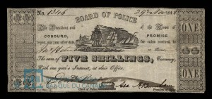a sepia coloured photograph of a five shilling promissory note issued by The President and Board of Police of the Town of Cobourg, No. 1346 dated 29th March 1848, with a picture of three sailboats and a lighthouse, signed by the Board President, Asa Burnham