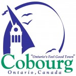 the word Cobourg appears in large green letters near the bottom with Ontario, Canada in blue beneath. Against a white background a stylized sail in blue outlines a cupola. The sail and three stylized birds, also in blue, are enclosed by a half circle blue ribbon.