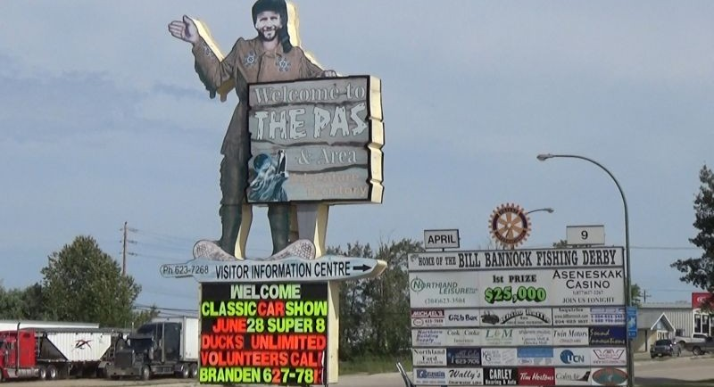 """Trapper's signage cut in the shape of the trapper holding a ""welcome to the Pas"" sign. Secondary sign to the right with a logo at top. Link to video for description"""