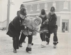 keystone kops arresting two fur queen contestants outside in front of a bank