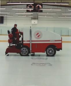 Man driving zamboni on indoor rink