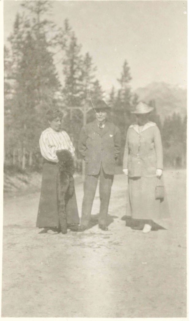 Photo of Belle (left), James (centre), and Miss Merritt (right) taken at Banff