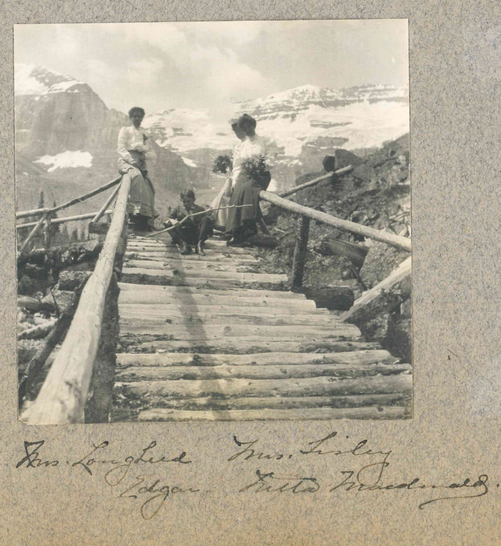 Photo of Isabella (left) on bridge in Banff with friends and her son Edgar.