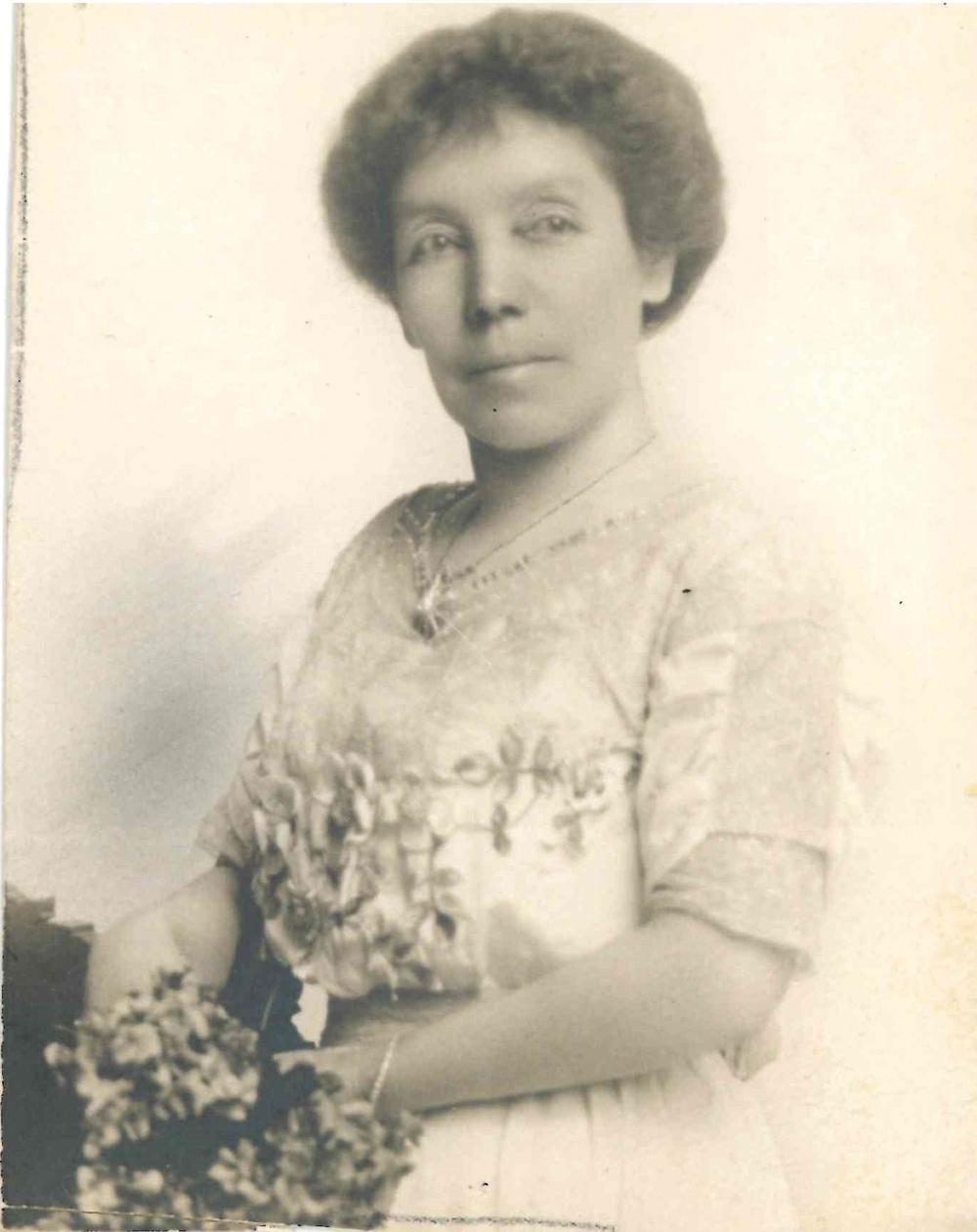 Photo of Isabella Lougheed, holding flowers.