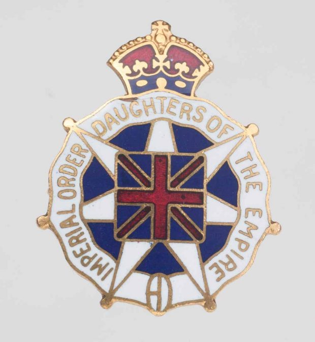 Enamel pin of the IODE with Union Jack in centre and crown on top.