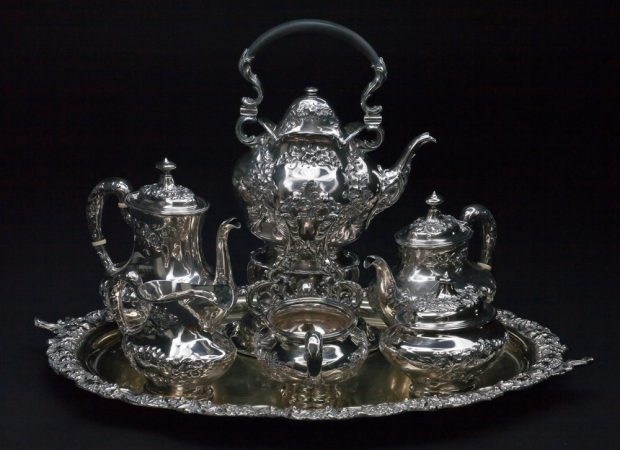 Photo of a silver tea set belonging to the Lougheeds with letter L engraved on the component parts