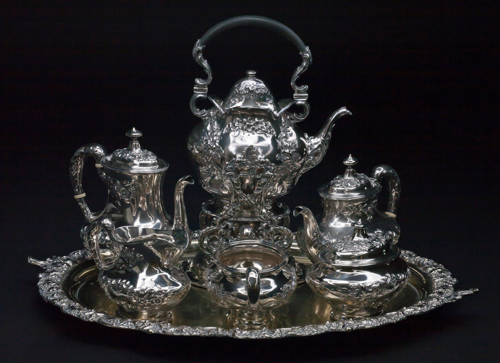 Photo of a silver tea set belonging to the Lougheeds with letter