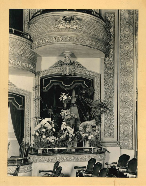 Photo of the Lougheed family box at the Grand Theatre. Flowers and wreaths suggest it may have been after the death of a family member.