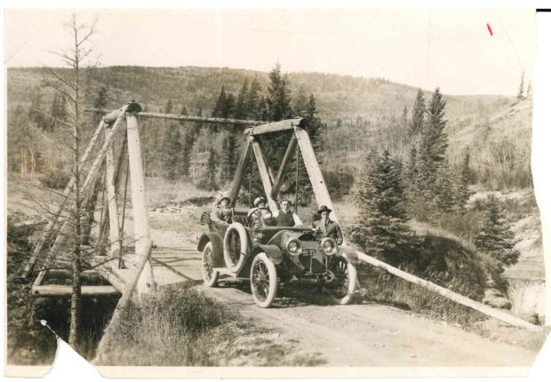 Family in car on bridge near Banff