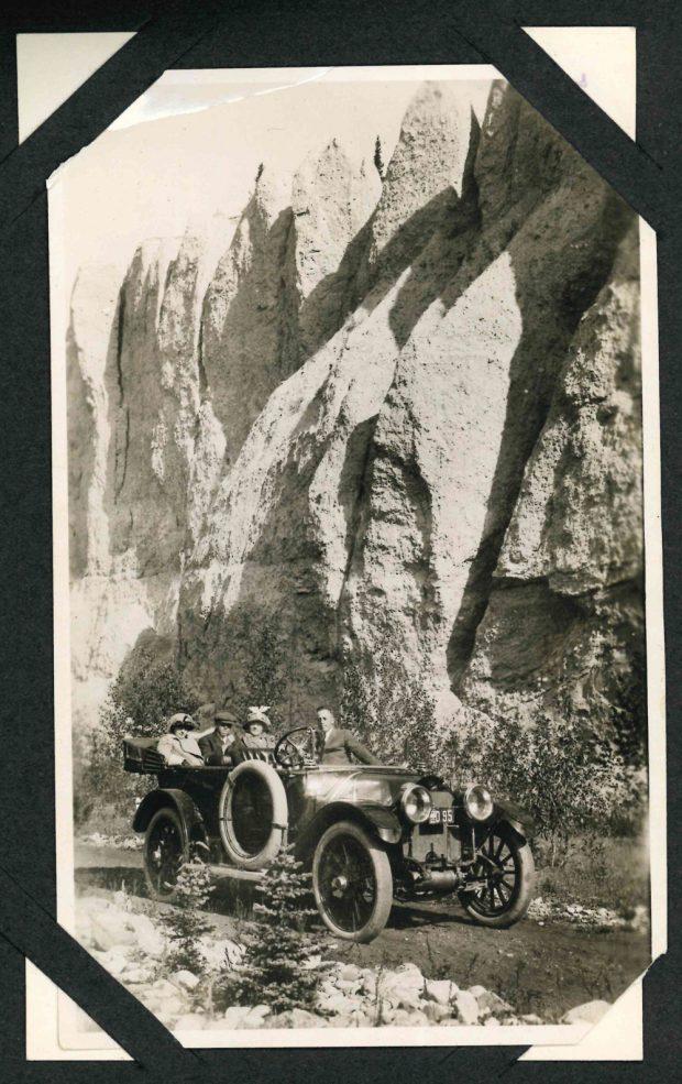 Photo of family members in car in Banff by Hoodoos
