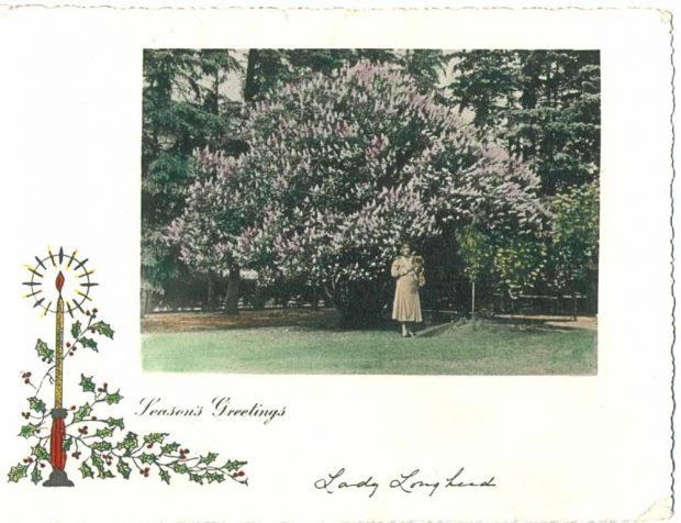 One of Lady Lougheed's Christmas cards with her photo in the garden